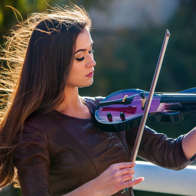 """Busker woman perform music on violin park outdoor. Girl performing ."" stock image"
