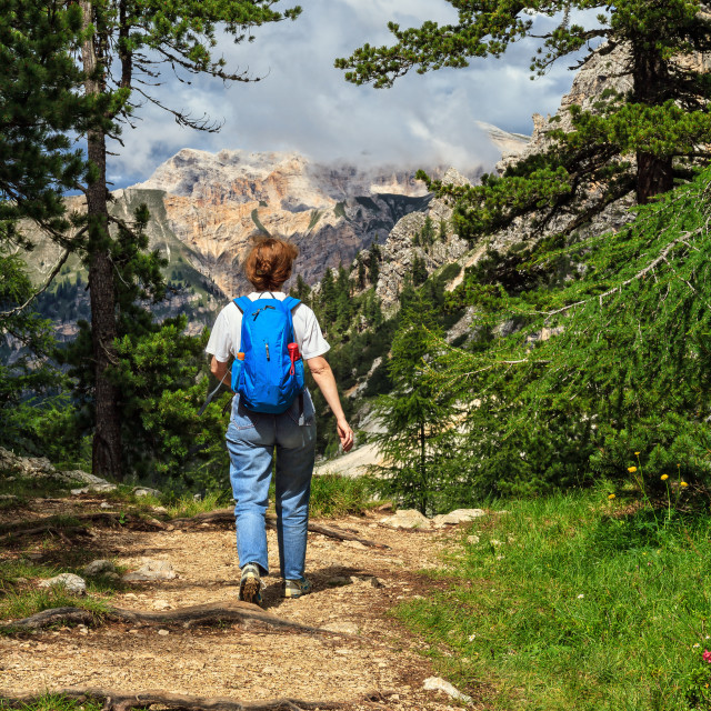 """Dolomiti - hiker walks on alpine path"" stock image"