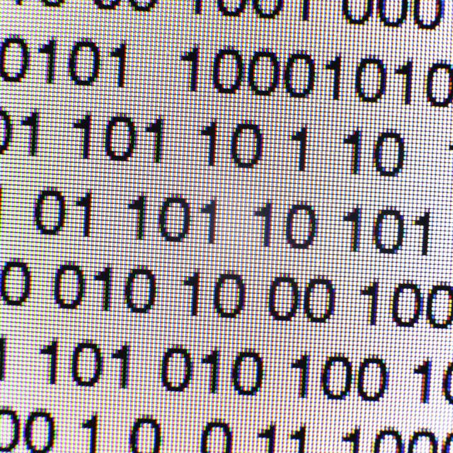 """Binary code on a computer screen"" stock image"