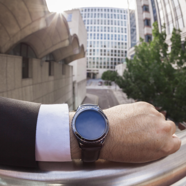 """Businessman wearing a smartwatch"" stock image"