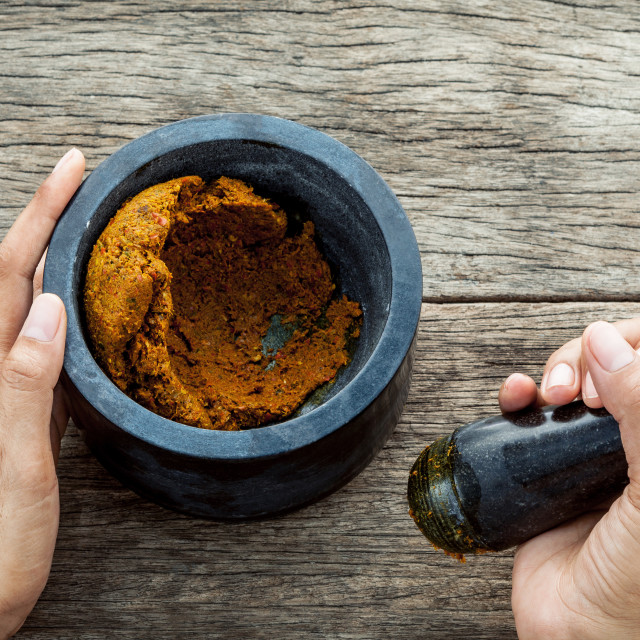 """""""The Women hold pestle with mortar and spice paste of thai popular food red..."""" stock image"""
