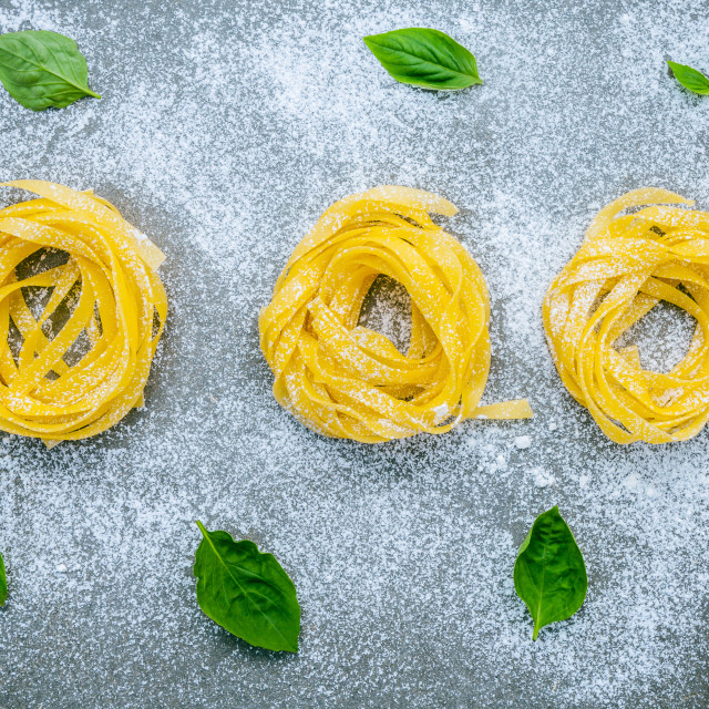 """""""Italian food concept pasta with sweet basil with flour setup on concrete..."""" stock image"""