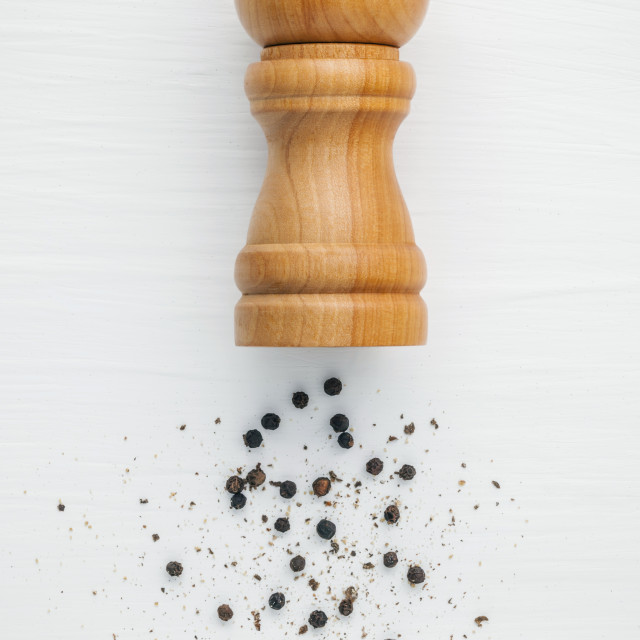 """""""Closeup black pepper in wooden spoon on shabby teak wood table. Seasoning and..."""" stock image"""
