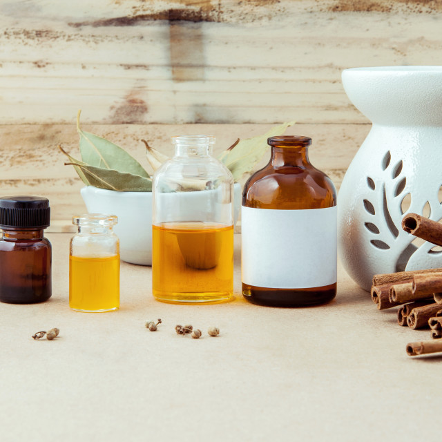 """""""Bottle of essential oil for ayurveda massage with cinnamon stick ,star anise..."""" stock image"""