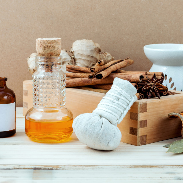 """""""Bottle of essential oil with cinnamon stick ,star anise ,bay leaves with..."""" stock image"""