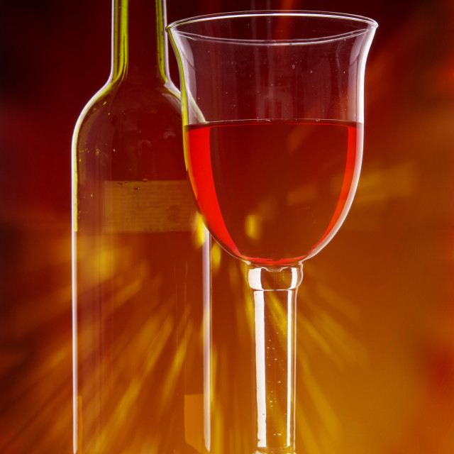 """Wine Glass and Bottle with Flare."" stock image"