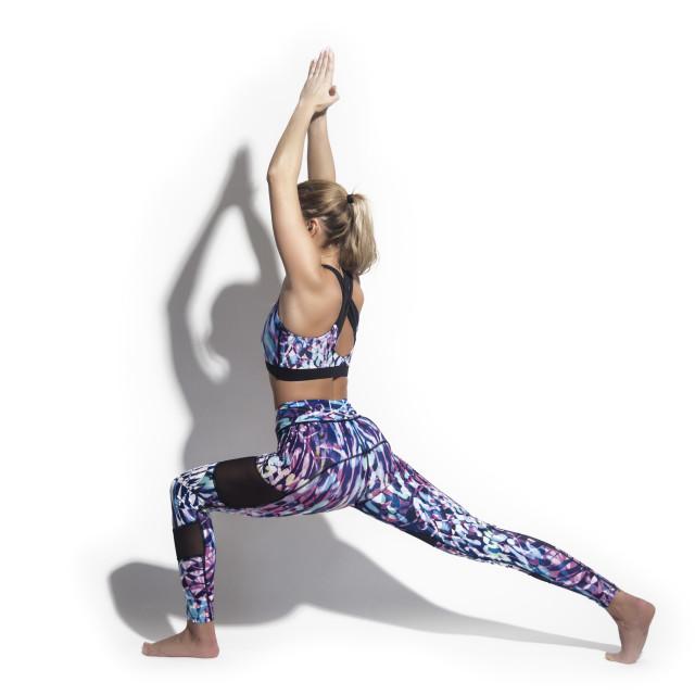"""woman wearing colourful sportswear, leggings and sports bra."" stock image"