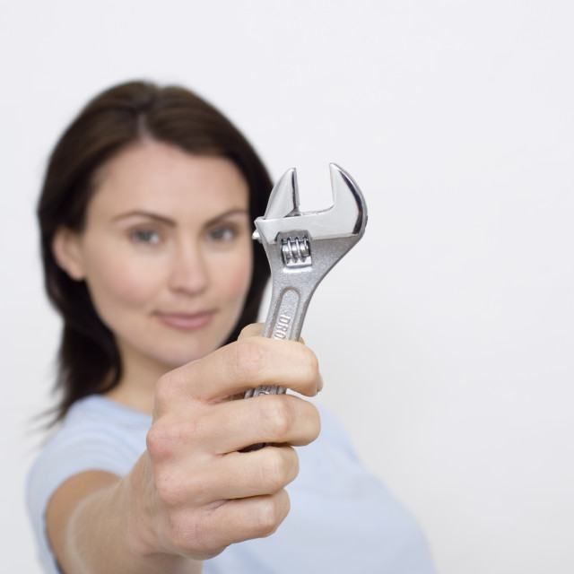 """women with an adjustable spanner"" stock image"