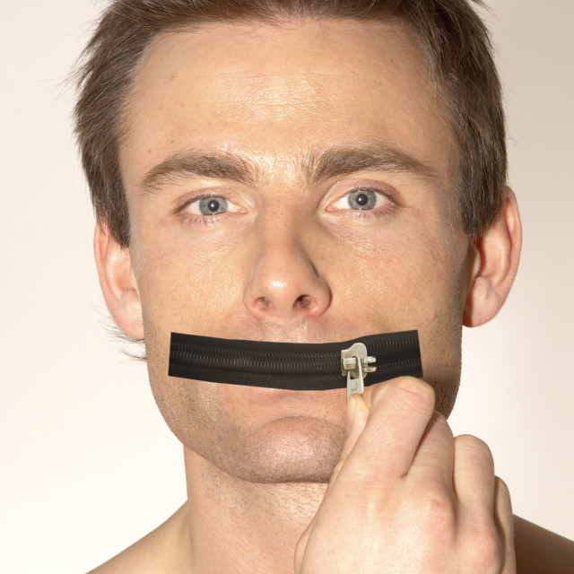 """man with a zip as a mouth, zip it, shut up, keep your mouth shut"" stock image"