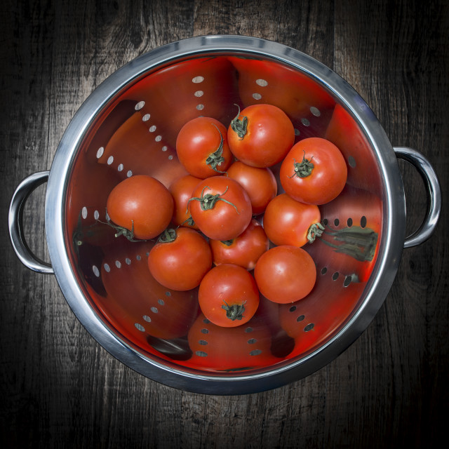 """ripe tomatoes in a metal colander"" stock image"