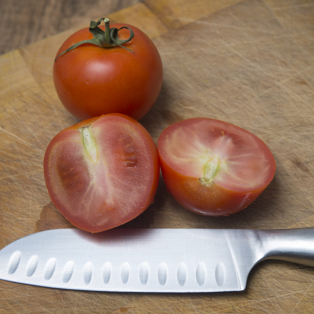 """chopped tomatoes with a stainless steel knife"" stock image"