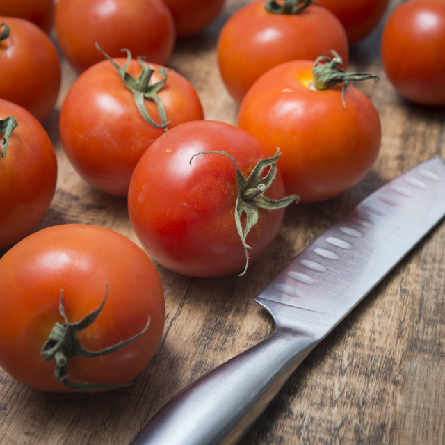 """tomatoes with a stainless steel knife"" stock image"