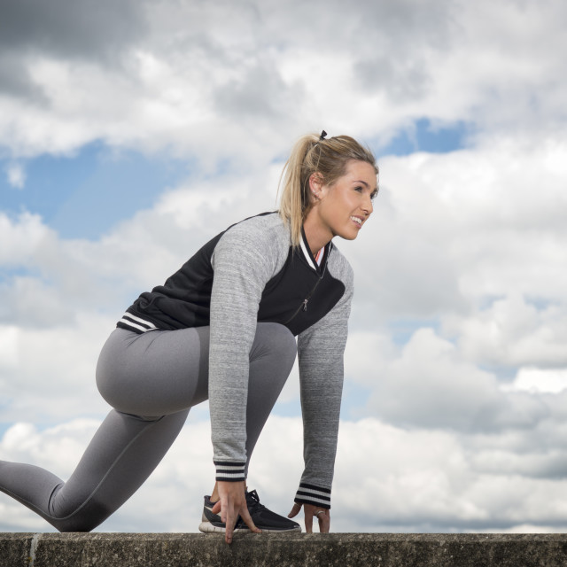 """""""woman getting ready to run, outdoors"""" stock image"""