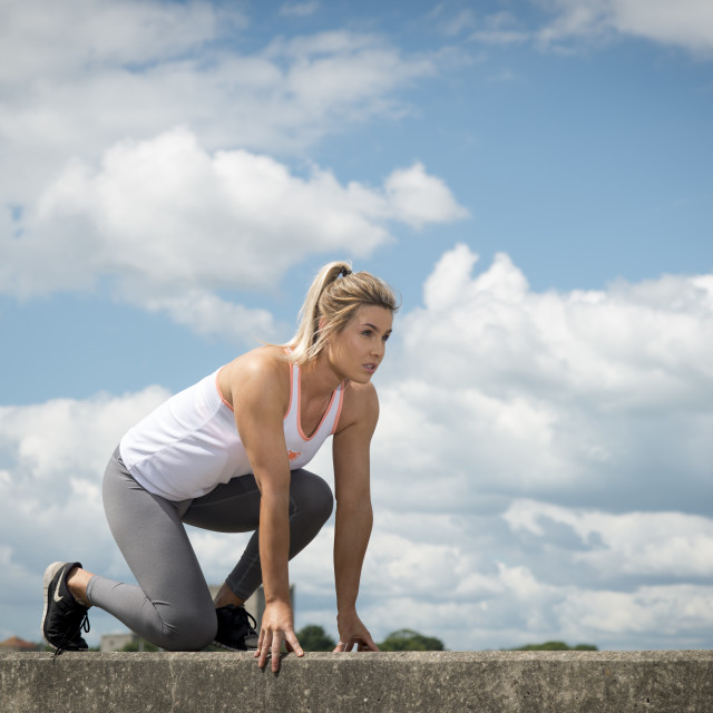 """""""fit woman getting ready to run"""" stock image"""