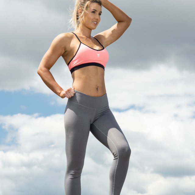 """""""fit woman wearing sports bra and leggins resting after training"""" stock image"""