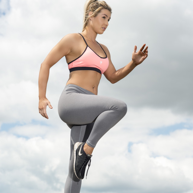"""fit woman wearing a sports bra and leggins training"" stock image"