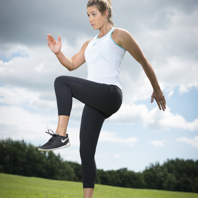 """""""fit woman running and jumping, keeping fit"""" stock image"""