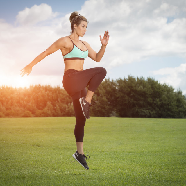 """fit woman running and jumping, keeping fit"" stock image"
