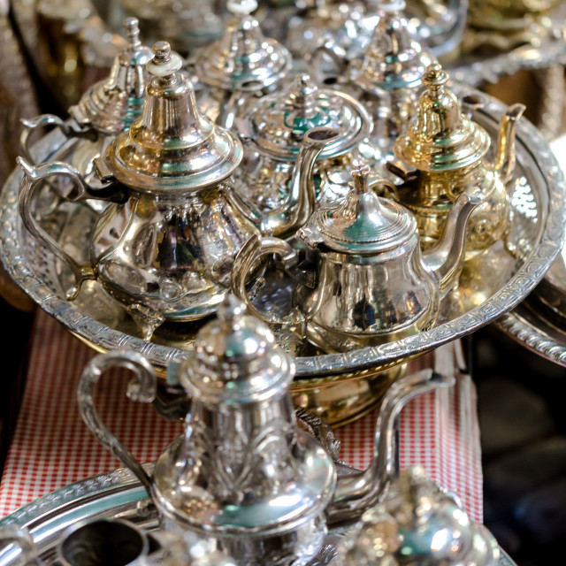 """Large group, collection, of silver platted arabic mint tea pots."" stock image"