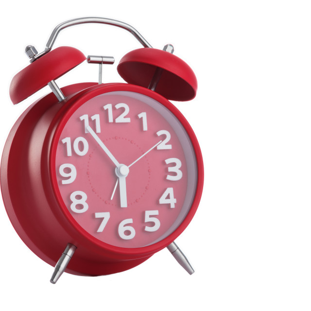 """Red alarm clock on white background"" stock image"