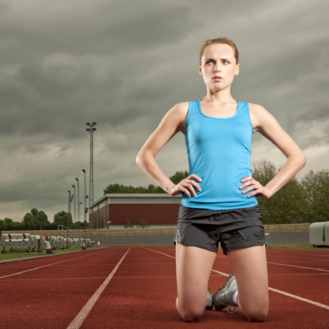"""woman on her knees after losing running race"" stock image"