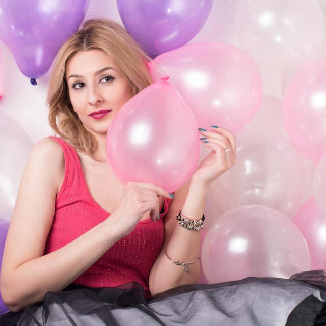 """""""young woman surrounded with balloones"""" stock image"""