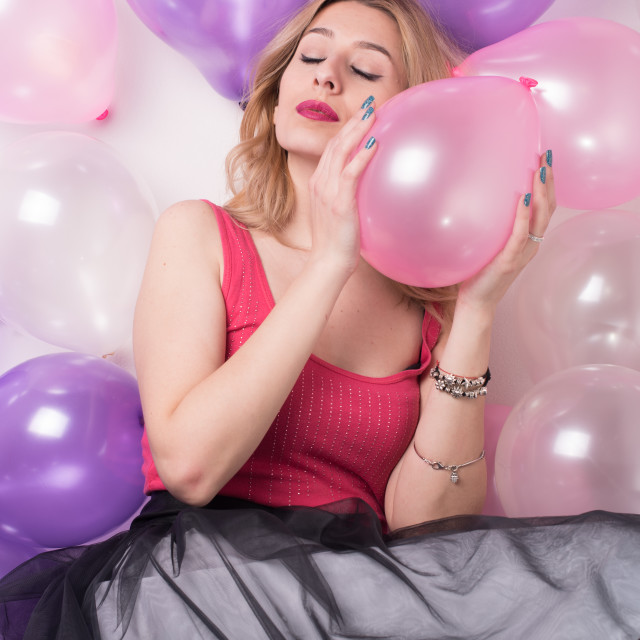 """""""young woman enjoying surrounded with balloons"""" stock image"""