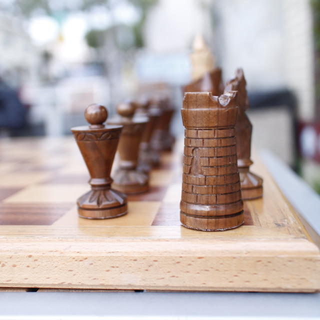 """vintage wooden chess set at outdoor table"" stock image"