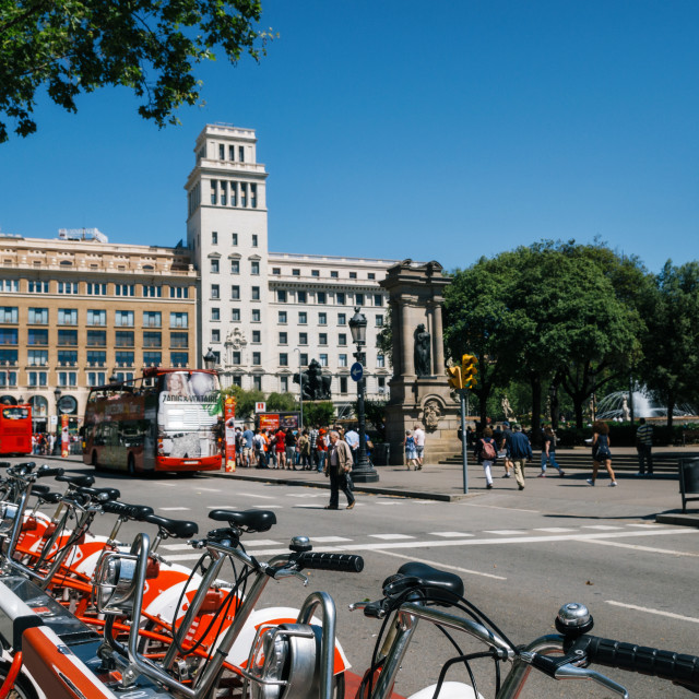 """View of Catalonia Square with famous architecture. Rental bikes of the foreground. Ecologic transport of the big city"" stock image"