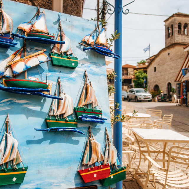 """Image of wooden model of sailing boat on blue door, Milos, Greece"" stock image"