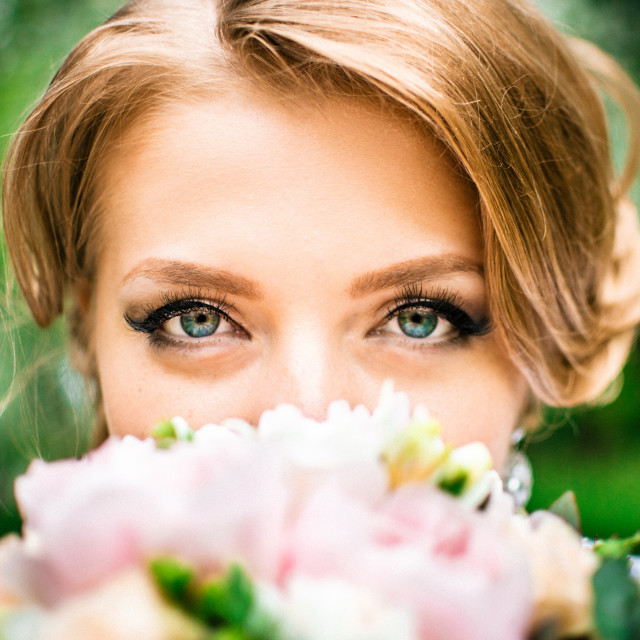 """Bride with large green eyes looks into the camera"" stock image"