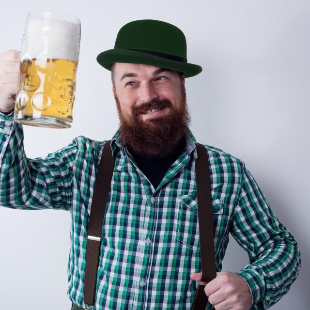 """young man holding beer mug"" stock image"