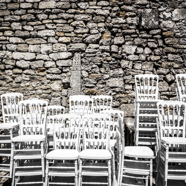 """""""Big group of chairs in a medieval garden"""" stock image"""