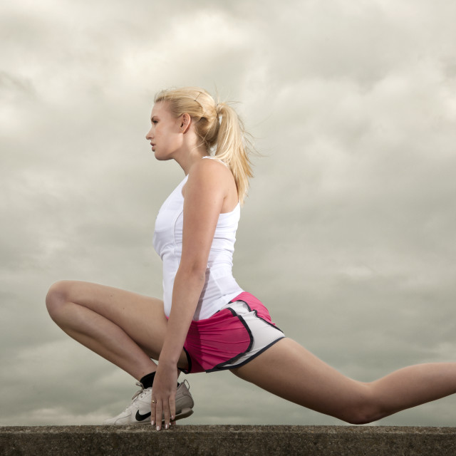 """woman stretching from exercising"" stock image"