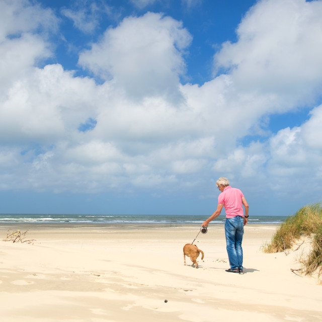 """""""Man with dog at the beach"""" stock image"""