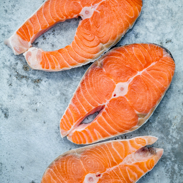 """Fresh salmon fillet sliced flat lay on shabby metal background. Fresh salmon..."" stock image"