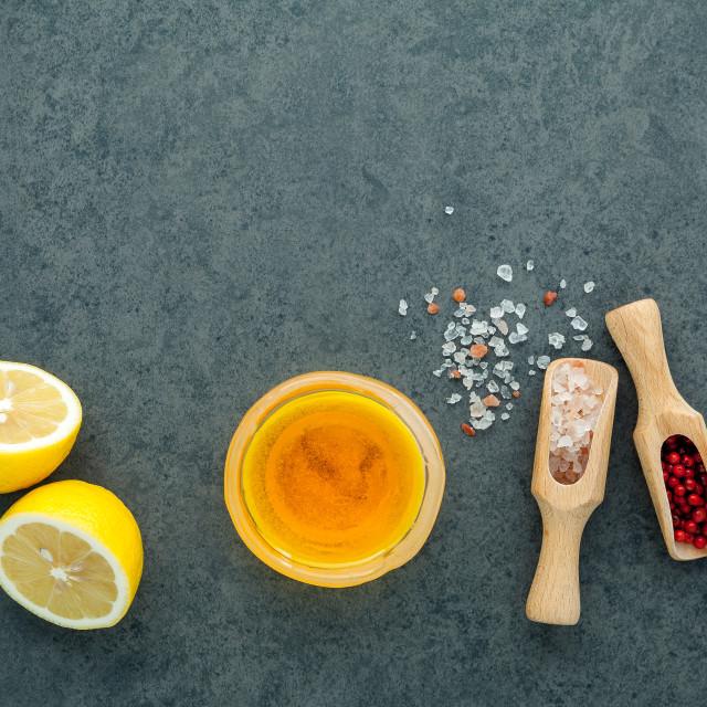 """The lemon vinaigrette dressing ingredients lemon, olive oil, himalayan salt..."" stock image"
