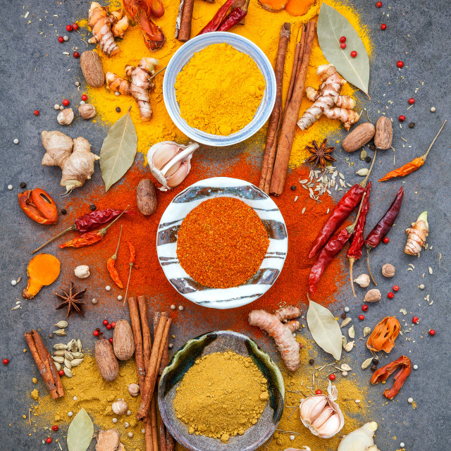 """Various of spices and herbs in ceramic bowl. Flat lay of spices ingredients..."" stock image"