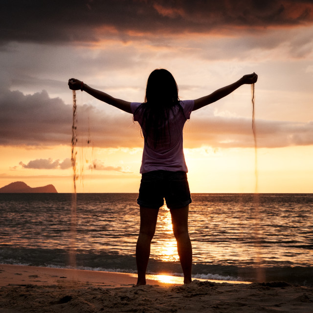 """Teen Girl at Sunset Beach"" stock image"