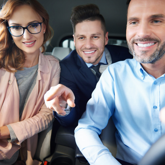 """""""Front view of salesman selling brand new car"""" stock image"""