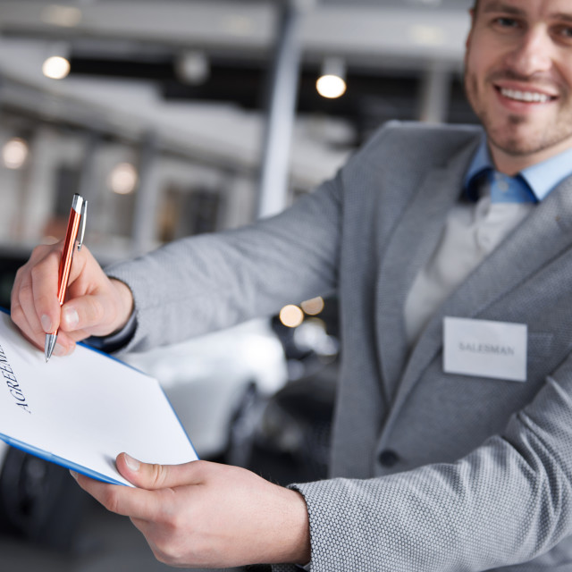 """""""Front view of salesman with agreement"""" stock image"""