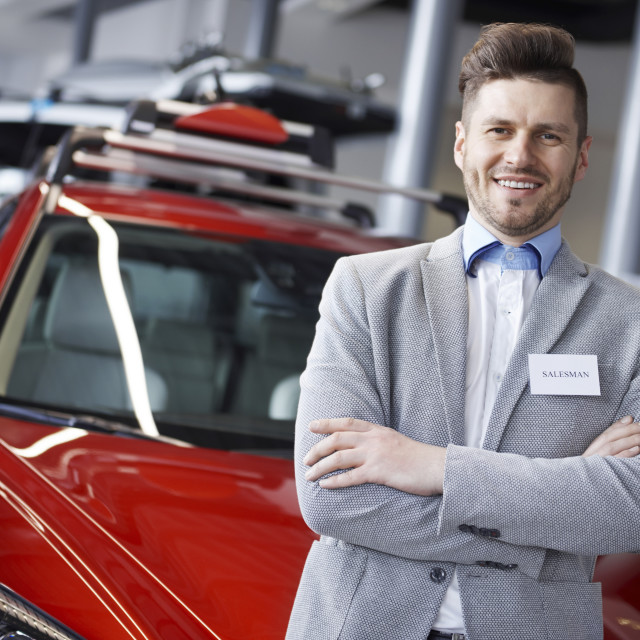 """""""Confident salesman with arms crossed"""" stock image"""
