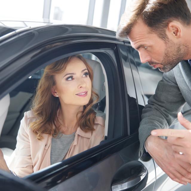 """Salesman giving an advice to female customer"" stock image"