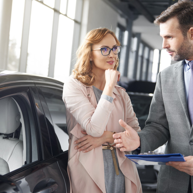 """""""Salesman having a talk with woman about contract"""" stock image"""