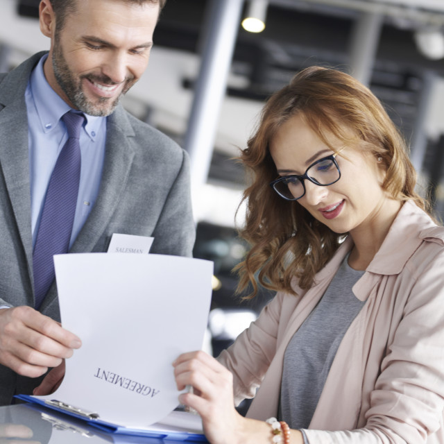 """""""Woman putting signature on the agreement"""" stock image"""