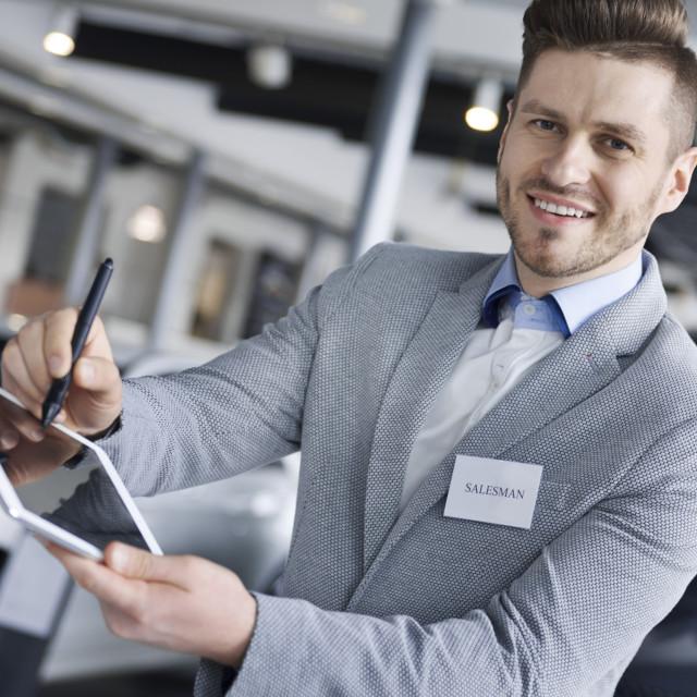 """""""Portrait of salesman holding digital tablet"""" stock image"""