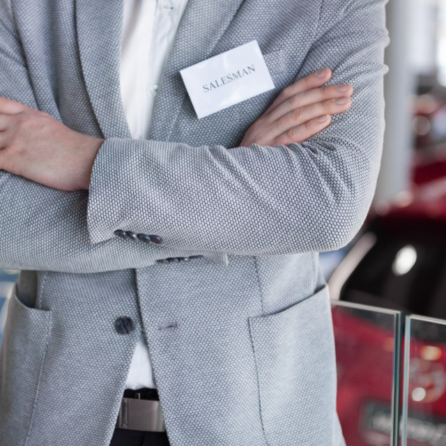 """""""Low section of arms crossed salesman"""" stock image"""