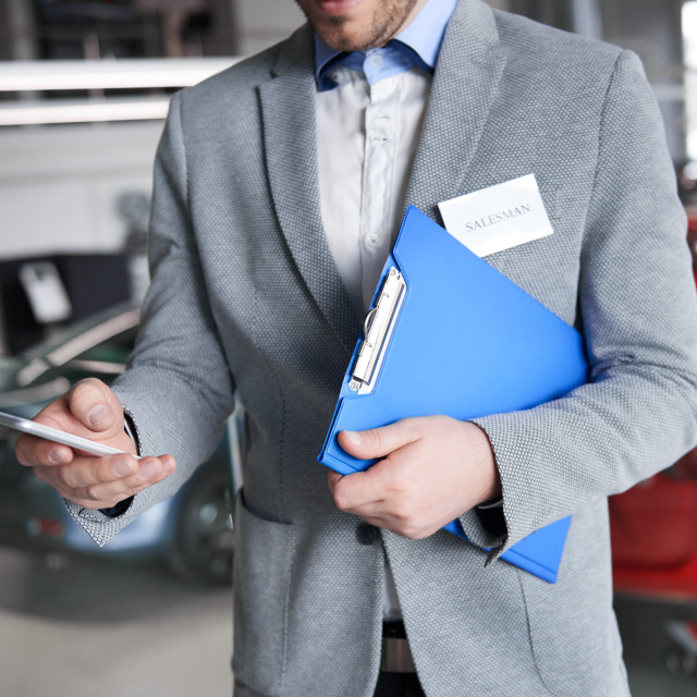 """""""Salesman using cell phone during work"""" stock image"""