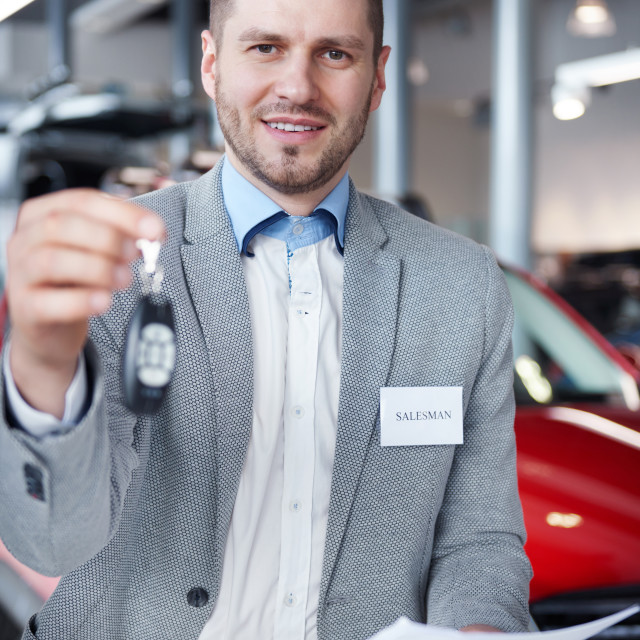 """""""Salesman with car keys in front of the camera"""" stock image"""