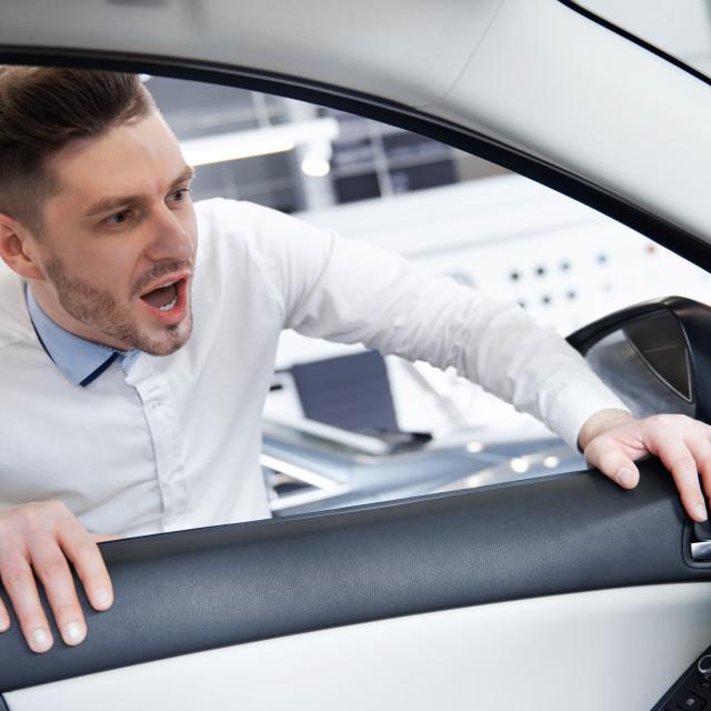 """Handsome man admiring the car interior"" stock image"
